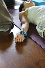 Woman Laying on Yoga Mat, Breathing